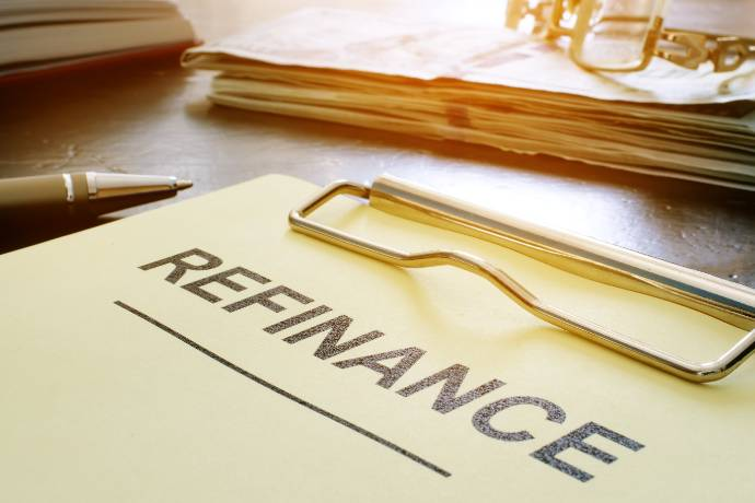 Refinance concept. Stack of business documents on table